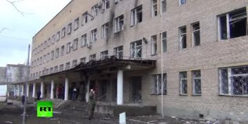 RAW Rocket attack on Donetsk hospital -  RT reports from aftermath