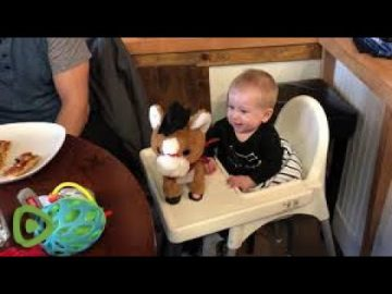 This baby's priceless reaction shows that he's not sure about his new toy