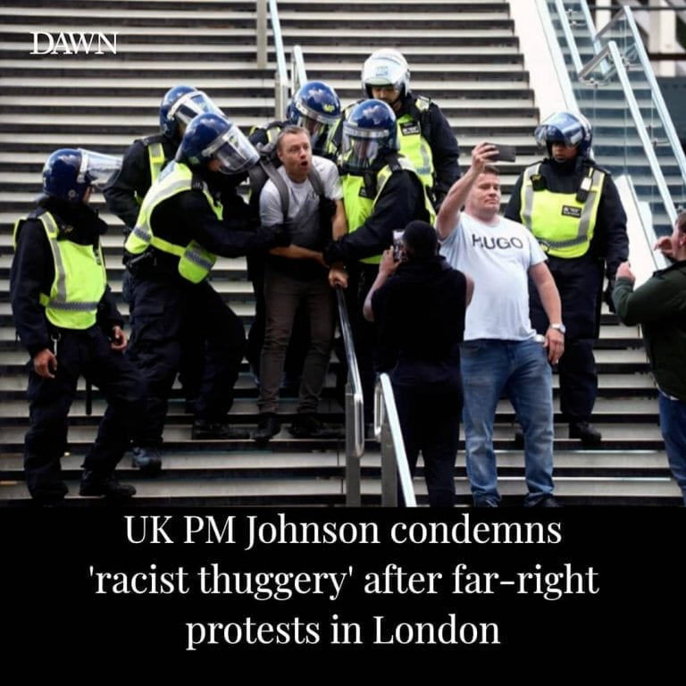 """British Prime Minister Boris Johnson condemned """"racist thuggery"""" after far-right... 3"""