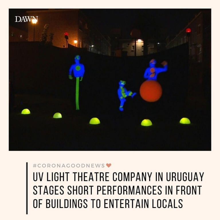 A UV light theatre company is staging short performances in front of buildings i... 3