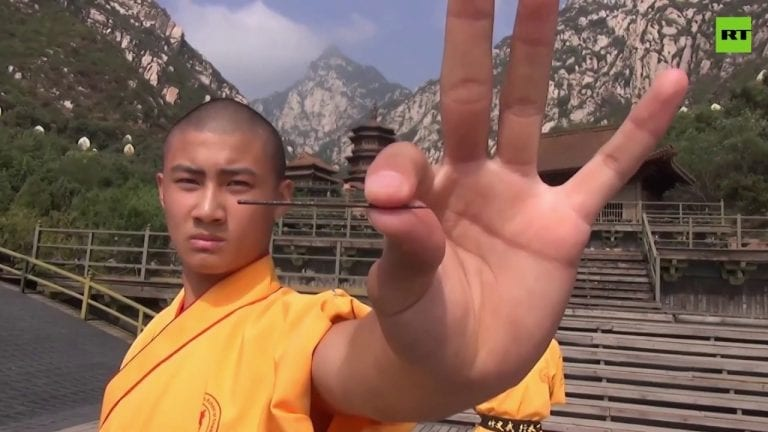 Shaolin-style | Monks pierce glass panes with needles
