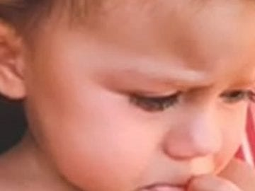 Sweet, tender-hearted baby girl cries when mommy sings