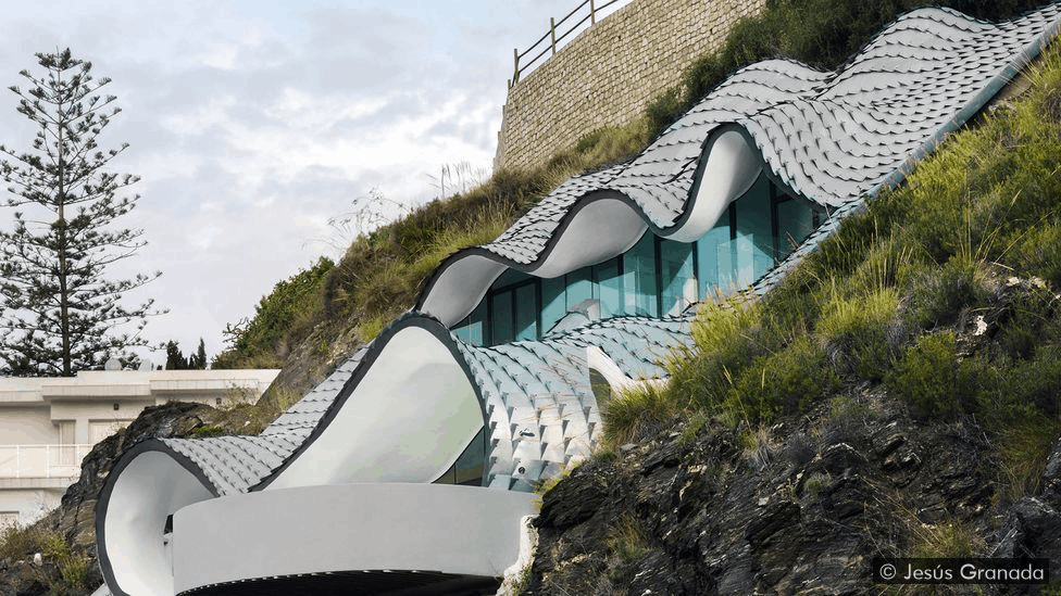 The zinc-clad roof has the appearance of scaly dragon skin (Credit: Jesús Granada)