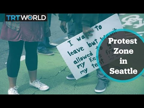 Police begin dismantling protest zone in Seattle