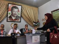 Syria's ruling party wins expected majority in parliamentary polls   AFP 19 hrs ago 18