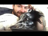 Goofy pup squeezes his head through owner's arm