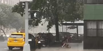 Unfortunate woman gets totally soaked during New York City downpour