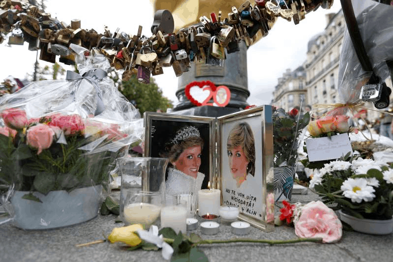 a bunch of food on a table: FILE PHOTO: Flowers and tributes are left in memory of the late Princess Diana around the Liberty Flame monument in Paris