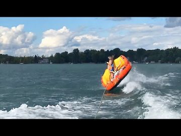 Epic wipeout: Kid gets flipped over while riding waterski tube