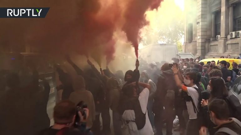 Students protest near university headquarters in Barcelona