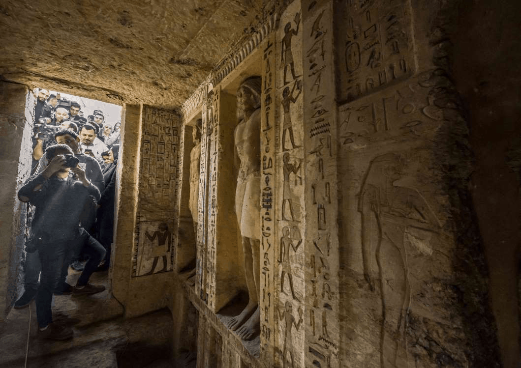 Slide 2 of 7: Journalists enter a newly-discovered tomb at the Saqqara necropolis, south of Cairo, on Dec. 15, 2018,