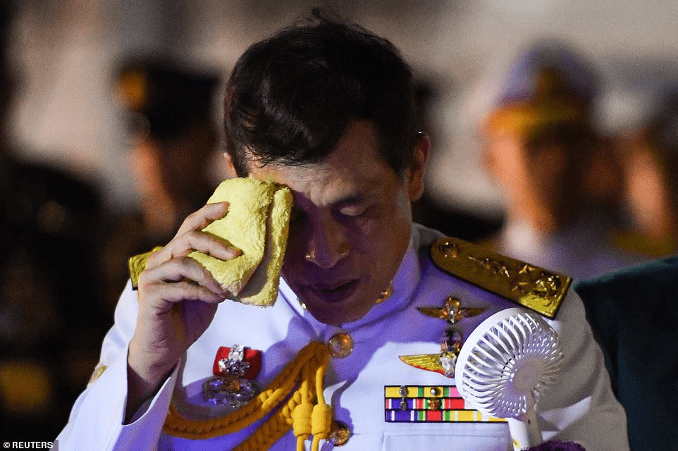 Thailand's King Maha Vajiralongkorn wipes sweat from his brow during an outing in Bangkok l;ast week