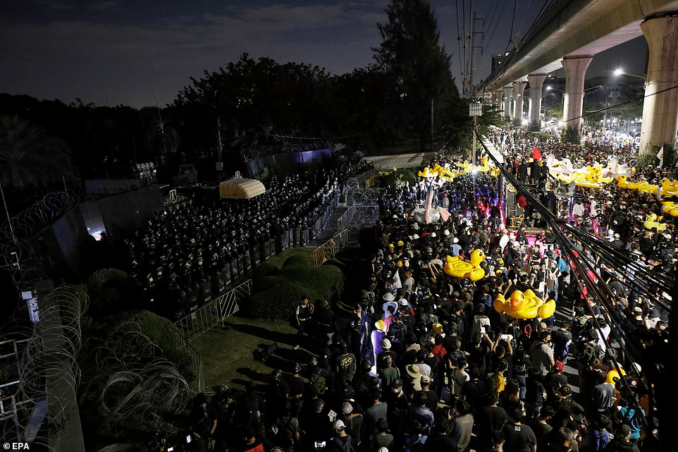 Thousands of protesters marched on Thailand's royal barracks last night holding inflatable rubber ducks - a symbol of the peaceful pro-democracy movement