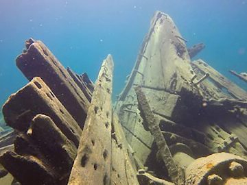 Scuba divers explore an eerie shipwreck in Devil Island Channel