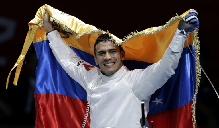Venezuelan Olympian delivers food to support family. 1