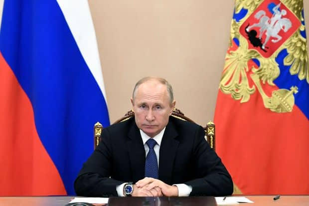 Russia's Putin says time for Syrian refugees to return home 1