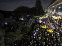Thousands of protesters marched on Thailand's royal barracks last night. 32