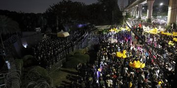 Thousands of protesters marched on Thailand's royal barracks last night. 20
