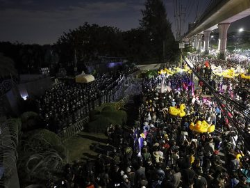 Thousands of protesters marched on Thailand's royal barracks last night. 10