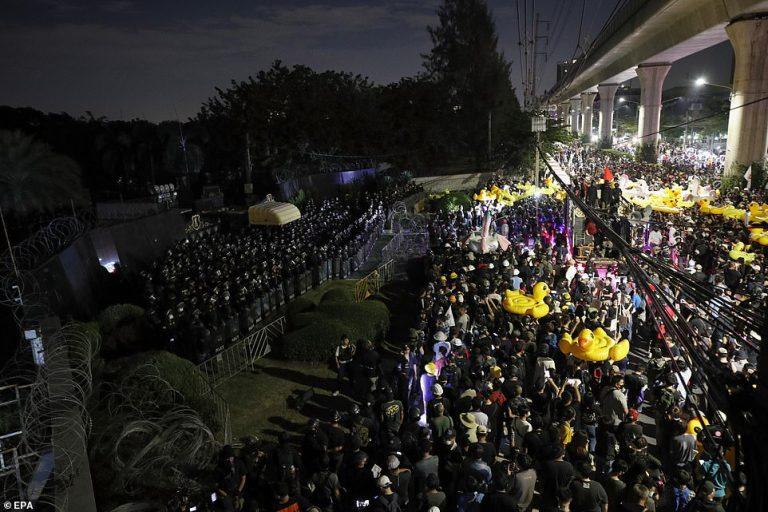 Thousands of protesters marched on Thailand's royal barracks last night. 1
