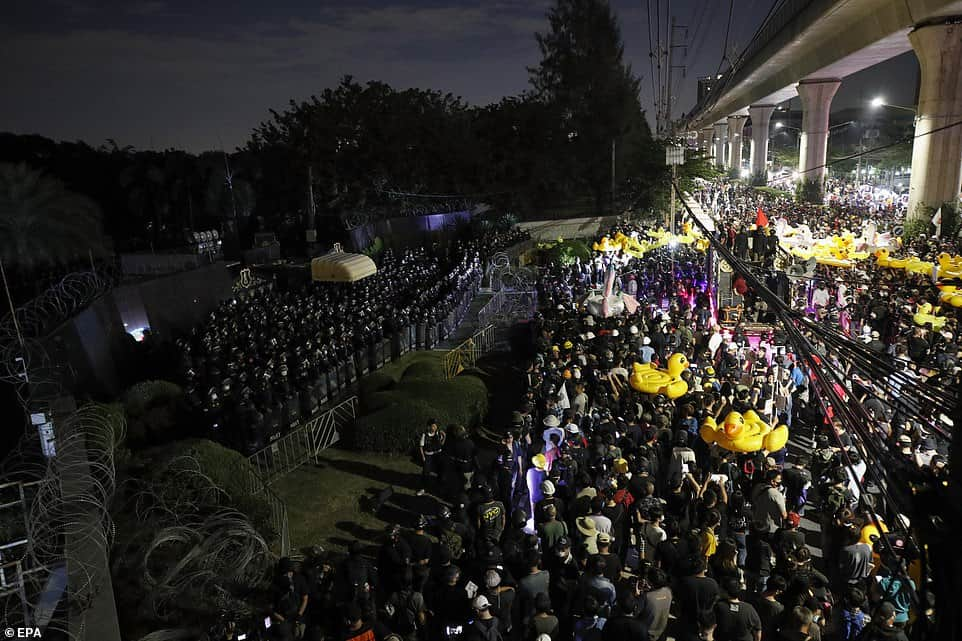 Thousands of protesters marched on Thailand's royal barracks last night. 4