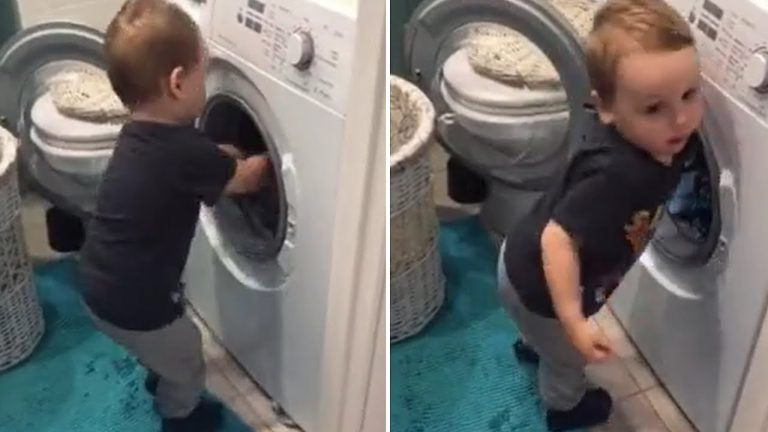 Caring toddler helps his mom with the laundry