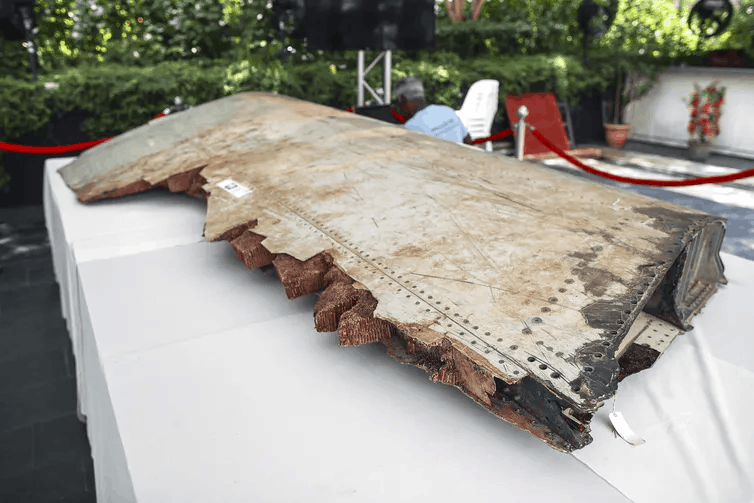 A piece of debris from missing flight MH370 displayed.