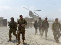 Taliban Call on Biden to Honor Trump Deal to Remove U.S. Troops 32
