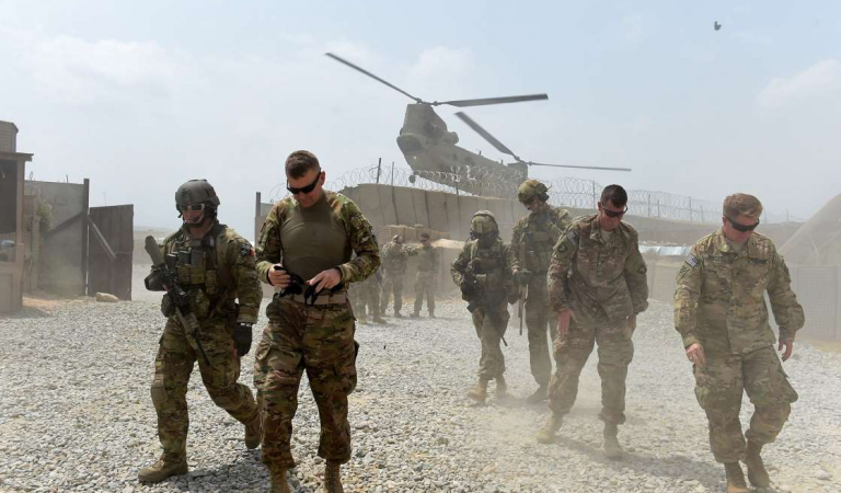 Taliban Call on Biden to Honor Trump Deal to Remove U.S. Troops