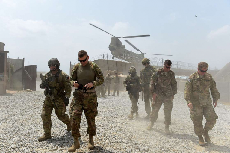 Taliban Call on Biden to Honor Trump Deal to Remove U.S. Troops 1