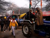 Protesting farmers breach barricade, enter Lal Qilla on India's Republic Day 32