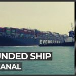 Suez Canal suspends traffic as tug boats work to free ship