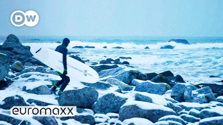 Arctic Surfing In The Freezing Waters Of The Lofoten Islands In Norway