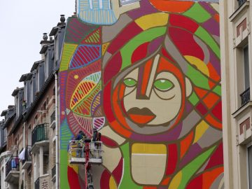 French street artists painting a massive mural in the French capital 1