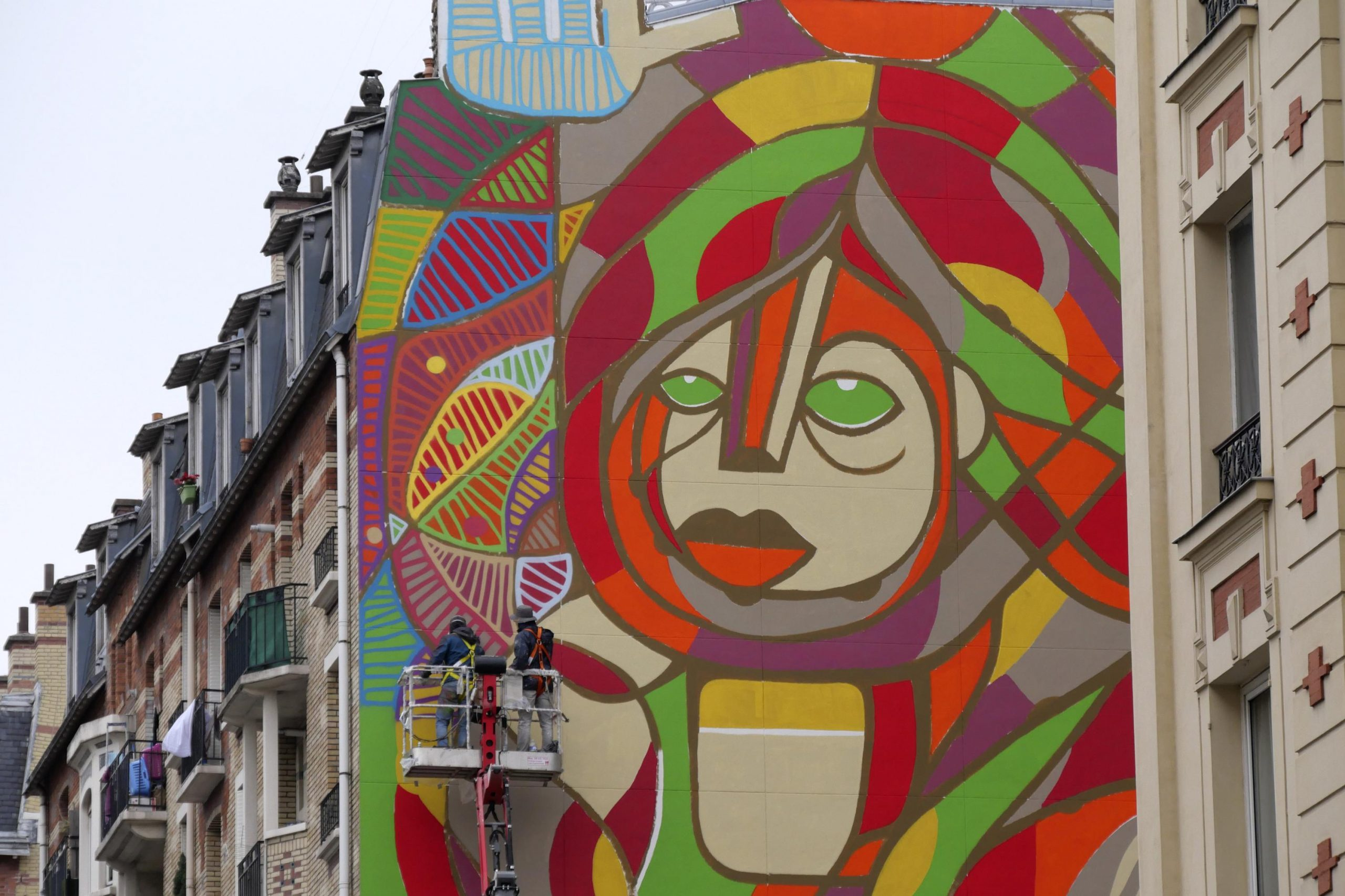 French street artists painting a massive mural in the French capital 3