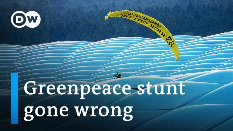 Greenpeace activist crashes Euro game in paraglider | DW News