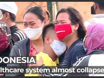 As COVID emergency measures start, Indonesians 'crying for help'