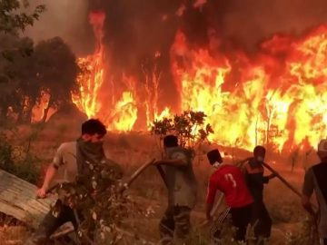 Villagers Without Tools Try to Battle Raging Wildfires